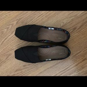 Black Toms canvas slip-on shoes